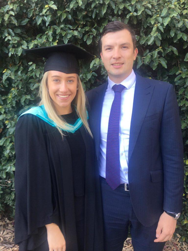 Emily Davis and partner at her graduation